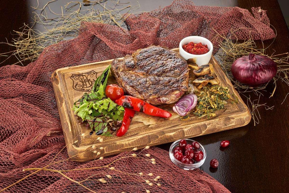 Закажите доставку из ресторана Стейка Рибай   Таверна Онейро
